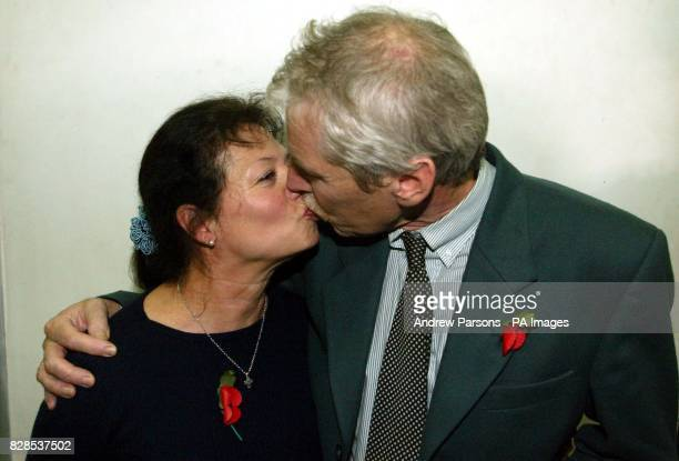 The British Plane Spotters Peter Norris from Uxbridge Middlesex kisses his wife Pertdita in Kalamata Court Greece as they win their appeal against...