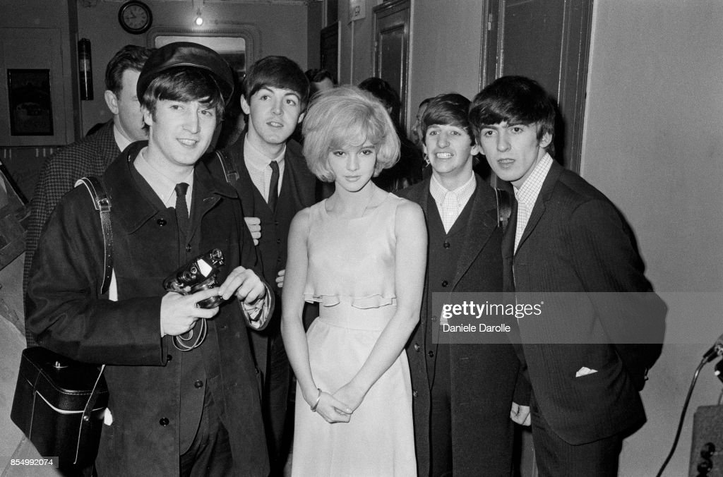 The British pop band The Beatles, left to right, John Lennon (1940 - 1980), Paul McCartney, Ringo Starr and George Harrison (1943 - 2001), after their Paris show, with their co-star the French singer Sylvie Vartan, 18th January 1964