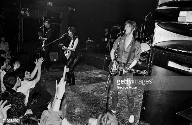 The British rock band The Pretenders Pete Farndon Chrissie Hynde and James HoneymanScott perform on stage during their first American concert tour...