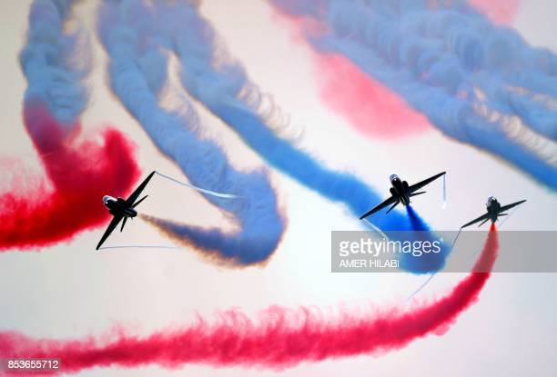 TOPSHOT The British Royal Air Force's aerobatic team the 'Red Arrows' performs aerial manoeuvres during celebrations marking Saudi Arabia's 87th...