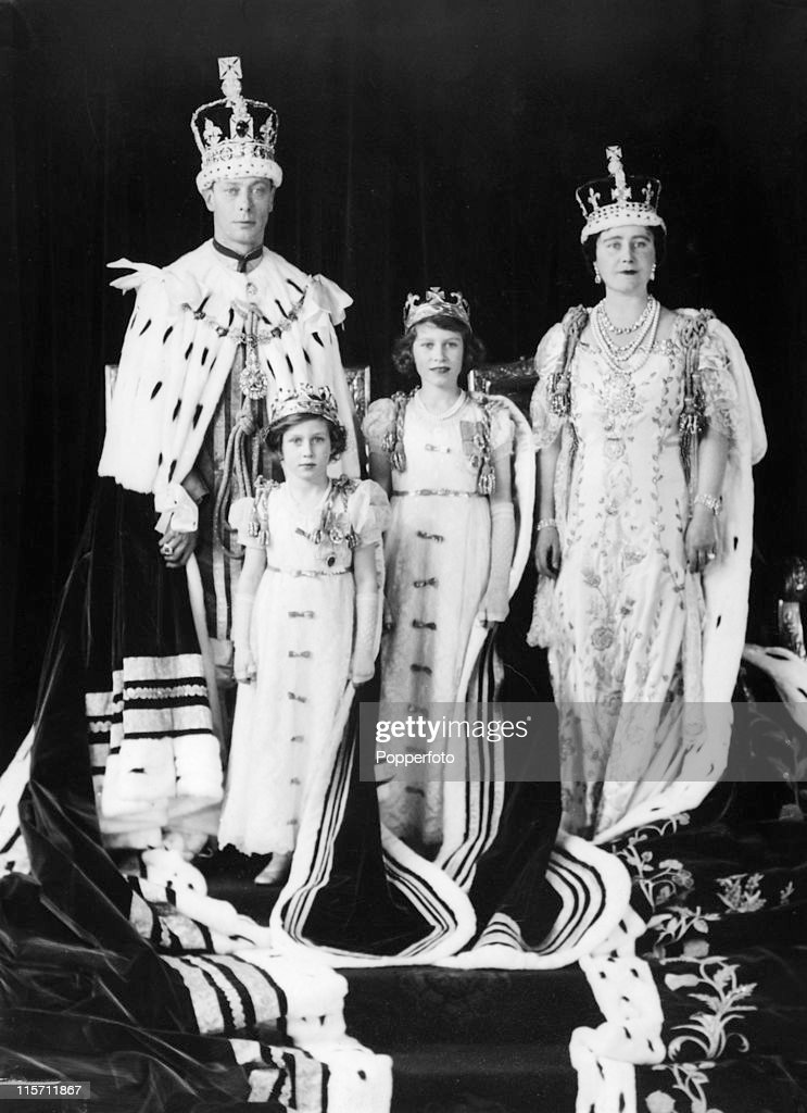 The British Royal Family in their coronation robes at Buckingham Palace after the coronation of King George VI on 12th May 1937. Left to right, King George VI, Princess Margaret, Prince Elizabeth and Queen Elizabeth. (Photo by Popperfoto/Getty Images).