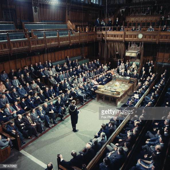 The British State Opening of Parliament ceremony commencing in the House of Commons with Black Rod's summons to the members to come to the other...