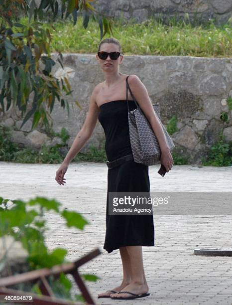 The British supermodel Kate Moss detoxing in famous holiday resort Bodrum takes a walk along the beach in Turkey on March 27 2014 The 39yearold...