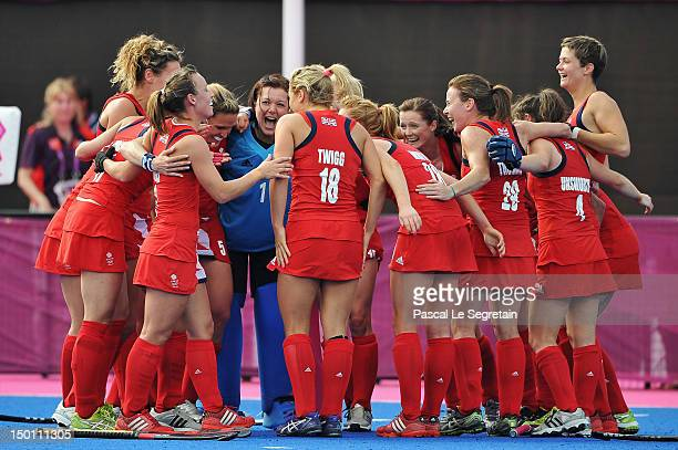 The British team celebrates after winning the Women's Hockey bronze medal match between New Zealand and Great Britain on Day 14 of the London 2012...