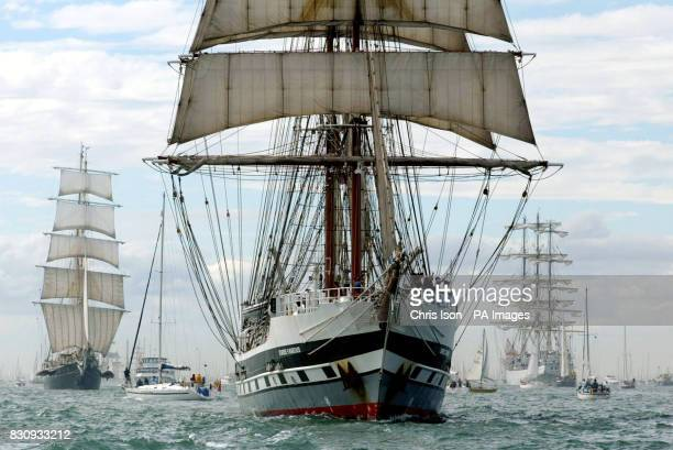 The British training ship Stavros S Niarchos leads the parade of sail in the Solent off Portsmouth A fleet of 65 sailing ships has been assembled in...