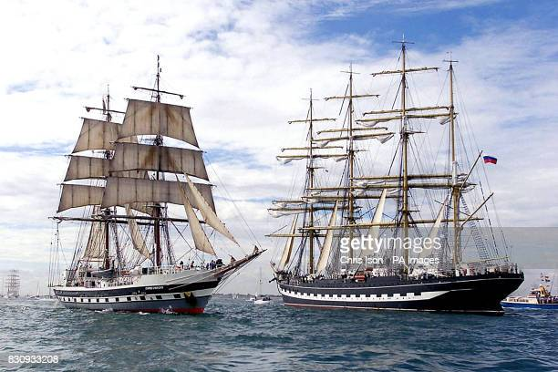 The British training ship Stavros S Niarchos passes the Russian square rigger Kruzenshtern during the parade of sail in the Solent off Portsmouth *A...