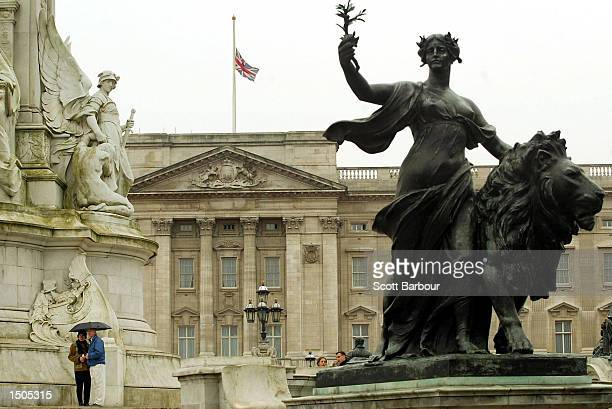 The British Union Flag flies at halfmast on the roof of Buckingham Palace October 20 2002 in London England The flag was lowered in tribute to those...