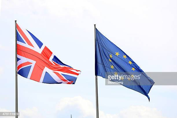 The British Union flag left and the European Union flag fly above the Chancellery in Berlin Germany on Friday May 29 2015 Chancellor Angela Merkel...