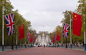 The British Union Jack flag and the Chinese Wu Xing Hong Qi flag line The Mall ahead of the Chinese State Visit on October 19 2015 in London England...