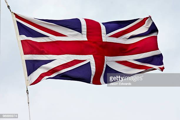 The British Union Jack flag flaps proudly in a stiff wind.