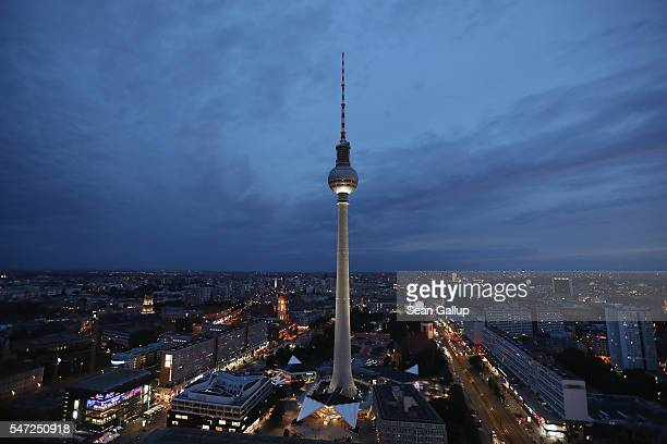 The broadcast tower at Alexanderplatz stands at twilight on July 13 2016 in Berlin Germany Berlin has succeeded in recent years in drawing young tech...