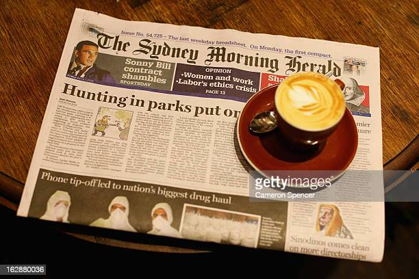 The broadsheet format 'Sydney Morning Herald' newspaper is seen at a cafe on March 1 2013 in Sydney Australia After 180 years the Monday to Friday...