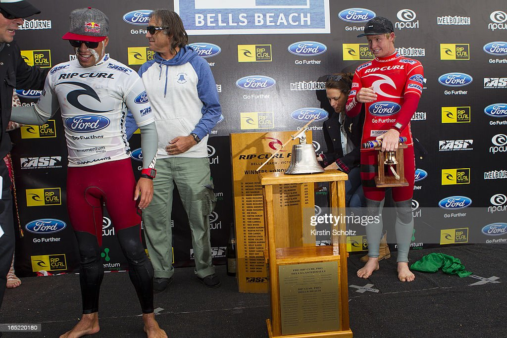 The broken bell off the trophy is seen during prizegiving with Adriano de Souza of Brasil (L) and Nat Young of the United States of America (R) at the Rip Curl Pro on April 2, 2013 in Bells Beach, Australia.