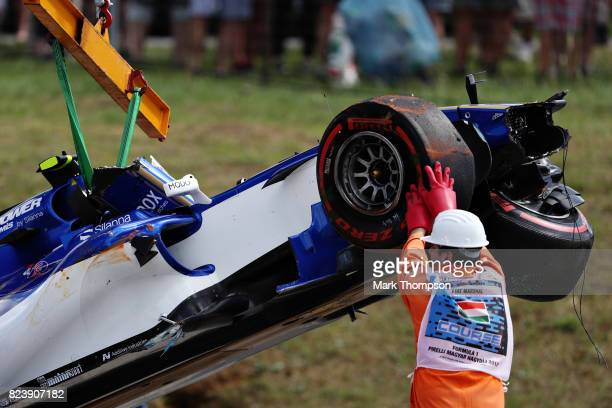 The broken car of Pascal Wehrlein of Germany and Sauber F1 is removed from the circuit during practice for the Formula One Grand Prix of Hungary at...