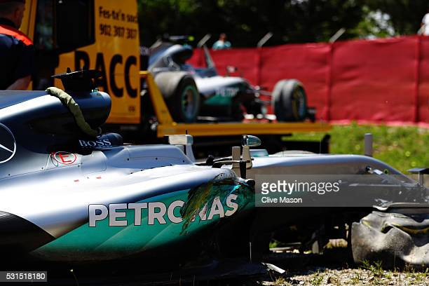 The broken cars of Lewis Hamilton of Great Britain and Mercedes GP and Nico Rosberg of Germany and Mercedes GP after they crashed into each other on...