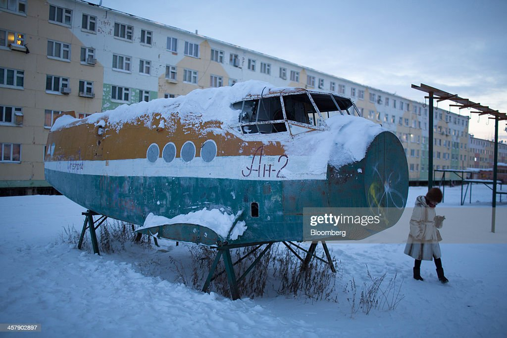 The broken fuselage of an old Antonov-2 aircraft stands in snow near a playground at the mining town of Udachny, Sakha Republic, Russia, on Monday, Dec. 16, 2013. Russia plans to maintain control of Mirny-based Alrosa, which produces a quarter of the world's diamonds by value and more rough diamonds than De Beers by carat. Photographer: Andrey Rudakov/Bloomberg via Getty Images