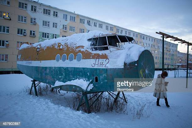 The broken fuselage of an old Antonov2 aircraft stands in snow near a playground at the mining town of Udachny Sakha Republic Russia on Monday Dec 16...
