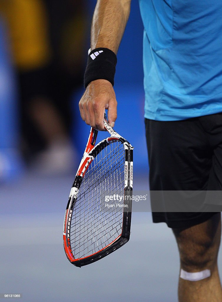 The broken racquet of Fernando Gonzalez of Chile is seen in his fourth round match against Andy Roddick of the United States of America during day seven of the 2010 Australian Open at Melbourne Park on January 24, 2010 in Melbourne, Australia.