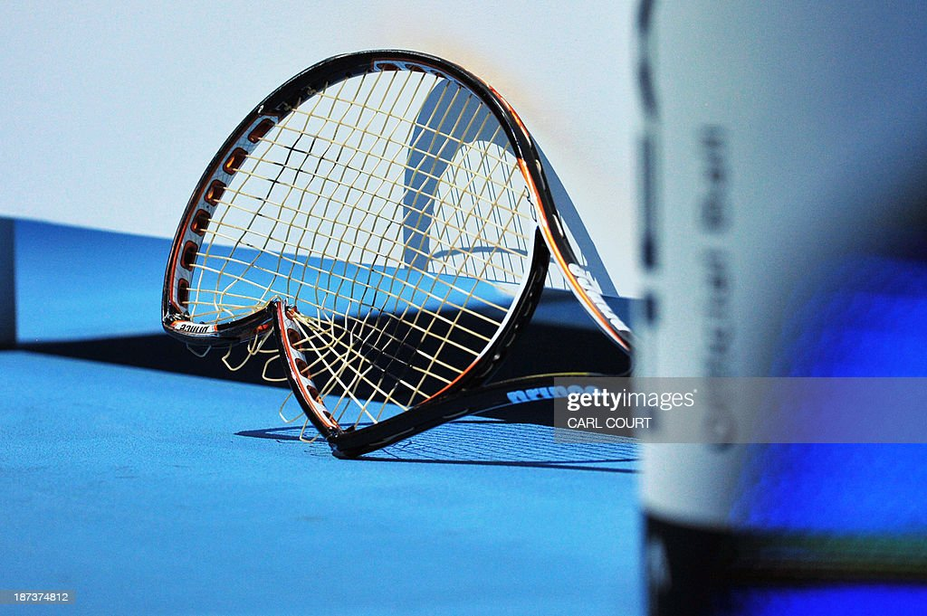 The broken racquet of Spain's David Ferrer lies on the ground behind his seat after Ferrer smashed it during his group A singles match against Switzerland's Stanislas Wawrinka in the round robin stage on the fifth day of the ATP World Tour Finals tennis tournament in London on November 8, 2013. Wawrinka won 6-7, 6-4, 6-1.