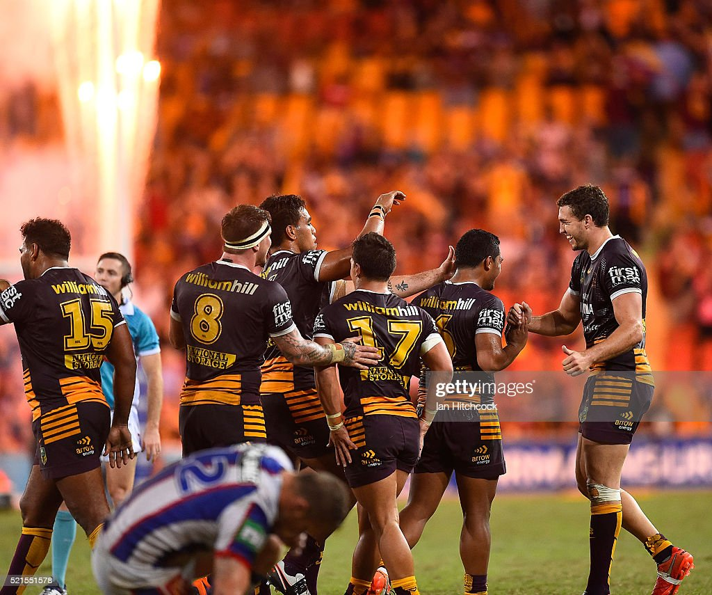 The Broncos celebrate after Anthony Milford (2nd right) of the Broncos kicked a field goal during the round seven NRL match between the Brisbane Broncos and the Newcastle Knights at Suncorp Stadium on April 16, 2016 in Brisbane, Australia.