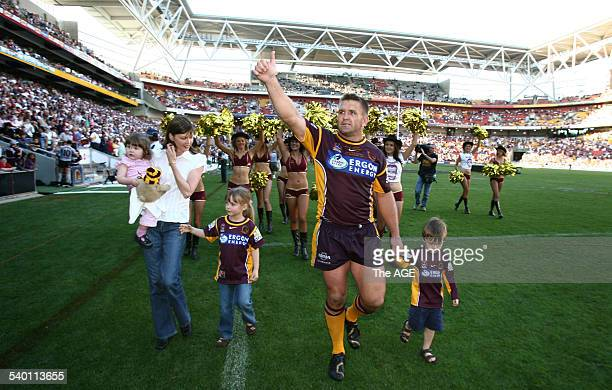 The Broncos' Shane Webcke does a lap of honour with his wife Allison with baby Grace daughter Erin and son Hayden after the NRL Round 26 rugby league...