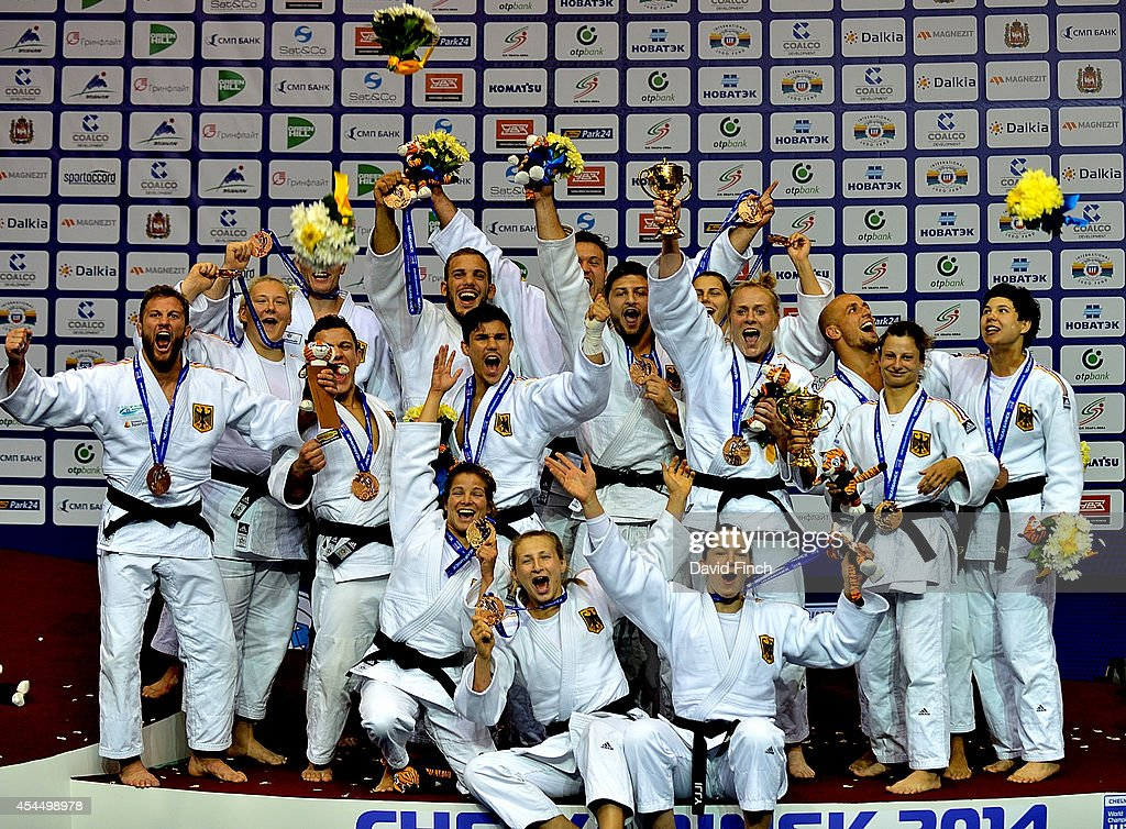 The bronze medal winning German Men and Women's teams (named by weight) Rene Schneider, Sebastian Seidl, Christopher Voelk, Sven Maresch, Marc Odenthal, <a gi-track='captionPersonalityLinkClicked' href=/galleries/search?phrase=Dimitri+Peters&family=editorial&specificpeople=875495 ng-click='$event.stopPropagation()'>Dimitri Peters</a>, Karl-Richard Frey, Andre Breitbarth, <a gi-track='captionPersonalityLinkClicked' href=/galleries/search?phrase=Romy+Tarangul&family=editorial&specificpeople=5434401 ng-click='$event.stopPropagation()'>Romy Tarangul</a>, Mareen Kraeh, Miryam Roper, Martyna Trajdos, Iljana Marzok, Laura Vargas Koch, Luise Malzahn, Jasmin Kuelbs and Franziska Konitz pose during the Chelyabinsk Judo World Team Championships at the Sport Arena 'Traktor' on August 31, 2014 in Chelyabinsk, Russia.