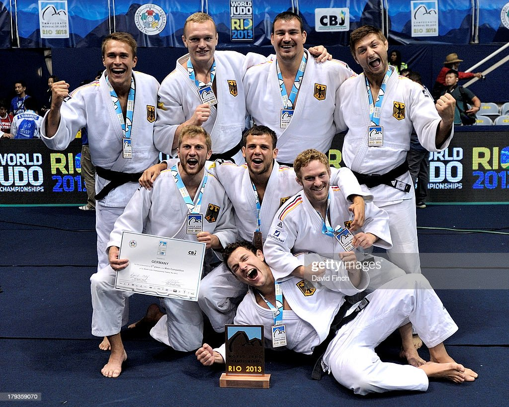 The bronze medal winning German team (L-R top to bottom): Alexander Wieczerzak, <a gi-track='captionPersonalityLinkClicked' href=/galleries/search?phrase=Dimitri+Peters&family=editorial&specificpeople=875495 ng-click='$event.stopPropagation()'>Dimitri Peters</a>, <a gi-track='captionPersonalityLinkClicked' href=/galleries/search?phrase=Andreas+Toelzer&family=editorial&specificpeople=607839 ng-click='$event.stopPropagation()'>Andreas Toelzer</a>, Marc Odenthal, Sebastian Seidl, Igor Wandtke, Tobias Englemaier and Sven Maresch enjoy the moment after the medal ceremony at the Rio World Judo Team Championships on Day 7 on September 01, 2013 at the Gympasium Maracanazinho in Rio de Janeiro, Brazil.