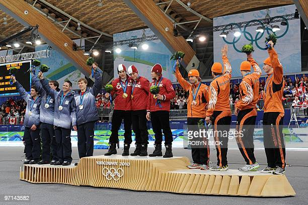 The bronze medalists from the Netherlands gold medalists Canada and silver medal winners from the US celebrate on the podium during the medals...