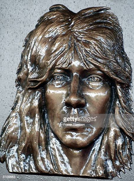 The bronze plaque of Randy Rhoads who was honored posthumously and inducted into the Hollywood Rockwalk on March 18 2004 in Hollywood California