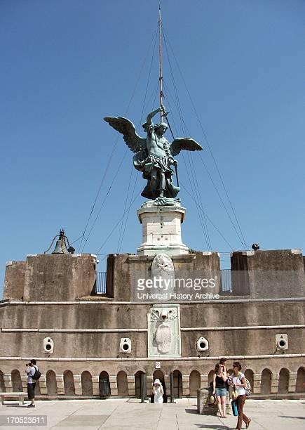 The bronze statue of Archangel Michael standing on top of the castle of St Angelo Rome modelled in 1753 by Peter Anton von Verschaffelt The Mausoleum...