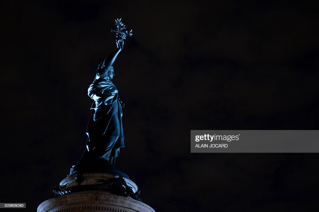 The bronze statue of Marianne is pictured on Place de la Republique during the Nuit Debout, or 'Up All Night' movement on April 28, 2016 on Place de la Republique in Paris. The 'Nuit Debout' demonstrations began on March 31 in opposition to the government's proposed labour reforms.