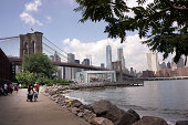The Brooklyn Bridge is viewed from a park in in DUMBO an acronym for Down Under the Manhattan Bridge Overpass on August 19 2014 in the Brooklyn...
