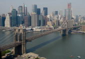 The Brooklyn Bridge lower Manhattan and East River are seen in this view of the New York City skyline from the air in a helicopter above New York...