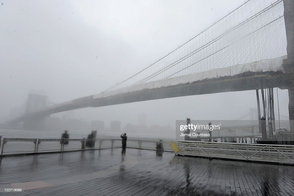 The Brooklyn Bridge stands shrouded in heavy rain and dark clouds as Hurricane Irene reaches the New York City area on August 28, 2011 in New York City. Hurricane Irene hit New York as a Category 1 storm before being downgraded to a tropical storm.