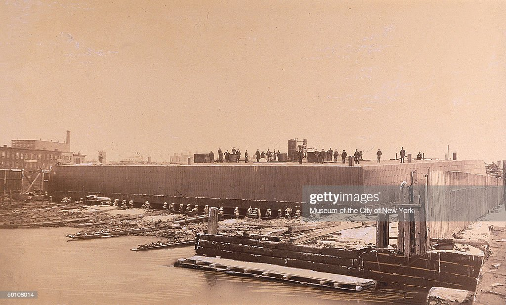 The Brooklyn caisson weighing 2800 tons is readied for 'sandhogs' to work inside during the Brooklyn Bridge construction once all the sand has been...