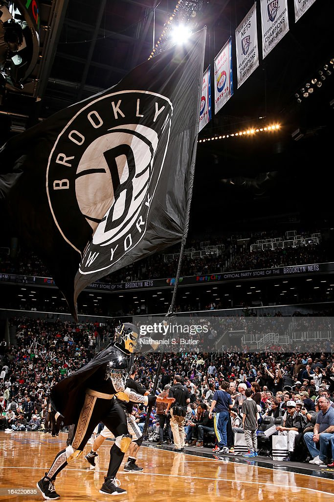 The Brooklyn Knight, mascot of the Brooklyn Nets, waves a flag during a game against the Atlanta Hawks on March 17, 2013 at the Barclays Center in the Brooklyn borough of New York City.