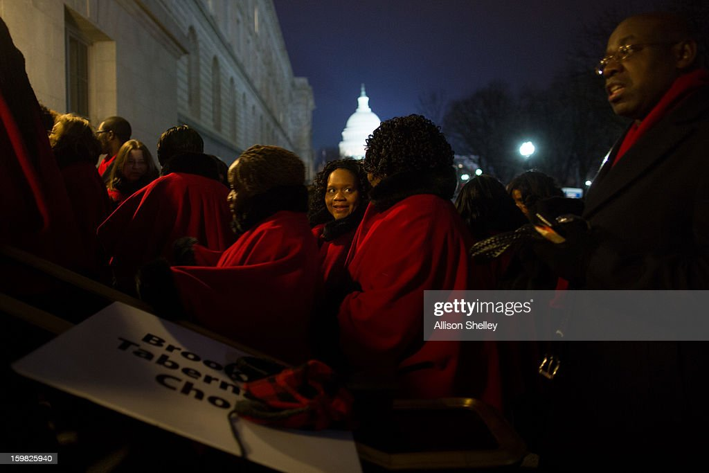 The Brooklyn Tabernacle Choir lines up at an entrance to the Senate Russell building before sunrise on Inauguration day for U.S. President Barack Obama at the U.S. Capitol building January 21, 2013 in Washington D.C. The choir will be singing The Battle Hymn of the Republic at the inauguration. U.S. President Barack Obama will be ceremonially sworn in for his second term today.