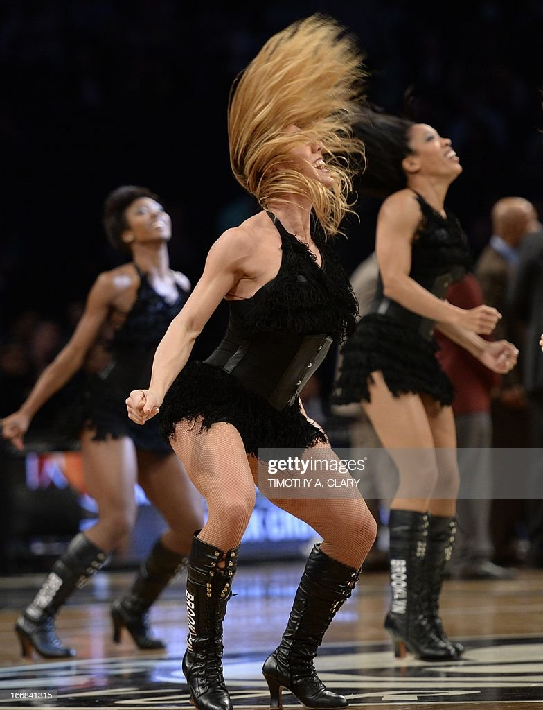 The Brooklynettes dancers perform during a time out between the Detroit Pistons against the Brooklyn Nets during their NBA game at the Barclays Center on April 17, 2013 in the Brooklyn borough of New York City.