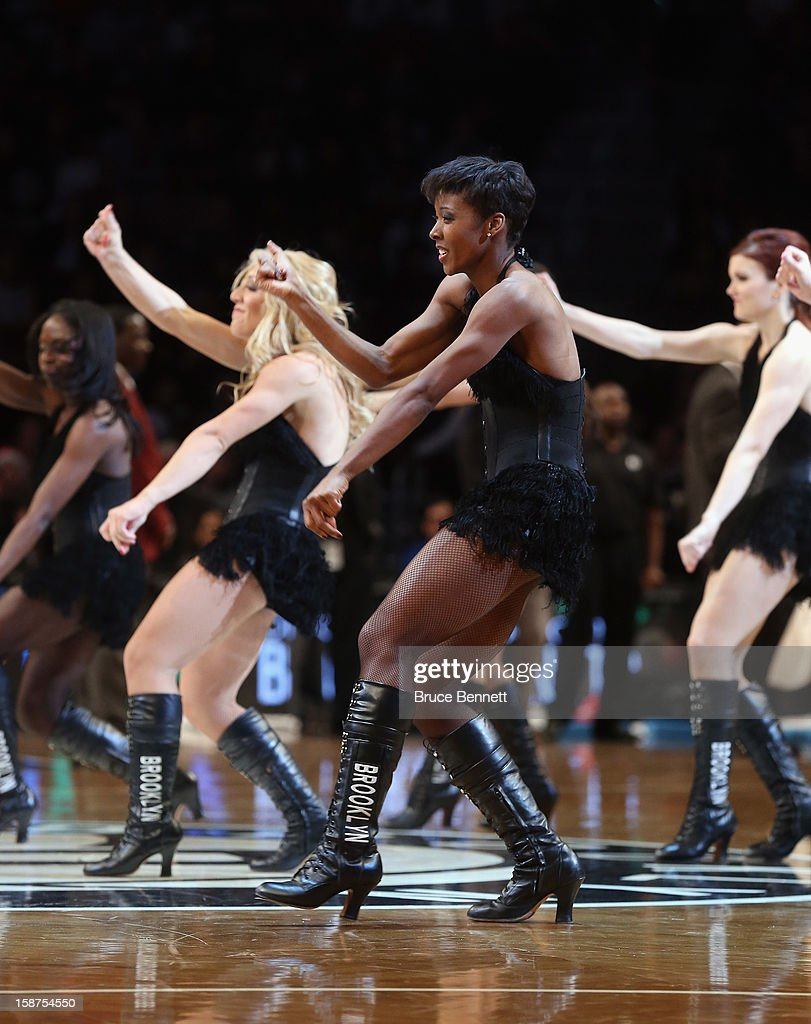 The Brooklynettes entertain during a break in the action between the Brooklyn Nets and the Philadelphia 76ers at Barclays Center on December 23, 2012 in the Brooklyn borough of New York City.