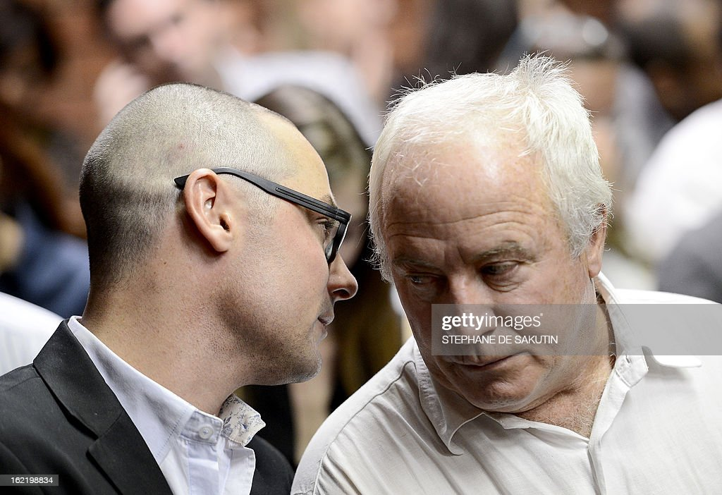 The brother and father of South African Olympic sprinter Oscar Pistorius Carl and Henke speak on February 20 2013 at the Magistrate Court in Pretoria...