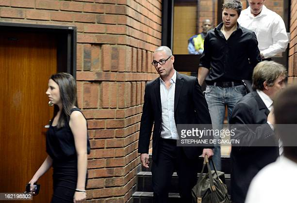 The brother and sister of South African Olympic sprinter Oscar Pistorius Aimee and Carl arrive on February 20 2013 at the Magistrate Court in...