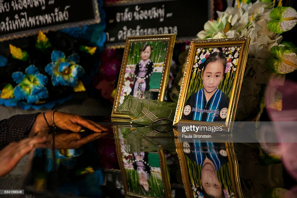 The brother of Chomphu, age 8, peers into her coffin during a memorial service in the Hmong community of Jom Thong, Chiang Mai province May 25, 2016. A tragic fire broke out on Sunday night killing at least 17 girls at the Pitakkiat Wittaya school, home to pupils from impoverished local hill tribes in the region, they were aged between 5 to 13. Based on reports, many of the 38 students were asleep when the fire swept through the elementary school in Chiang Rai Province and investigations are still being carried out to find the cause of the fire.