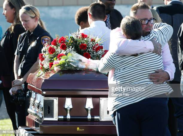 The brother of Heather Lorraine Alvarado is given a hug after his sisters graveside service at the cemetery on October 13 2017 in Enoch Utah Alvarado...
