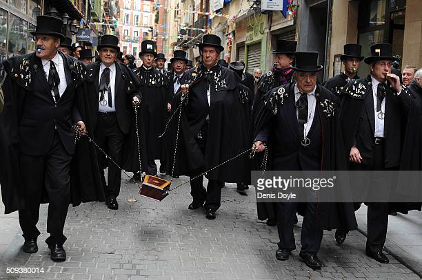 The Brotherhood of the ''Burial of the Sardine'' carry a coffin containing an artificial sardine during the Burial of the Sardine procession on...