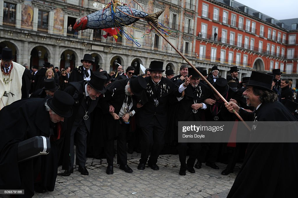 The Brotherhood of the ''Burial of the Sardine'' dance in Mayor square during the Burial of the Sardine procession on February 10, 2016 in Madrid, Spain. The Sardine procession is a centuries-old Spanish tradition made famous by a painting by Spanish artist Francisco de Goya called 'El Entierro de La Sardina'. The mourners hold a mock funeral procession mourning the end of Carnival through the heart of old 'Castizo' Madrid visiting and enjoying the wines and tapas of local taverns.
