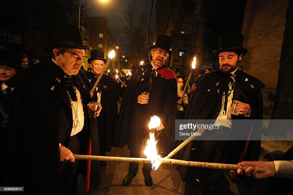 The Brotherhood of the ''Burial of the Sardine'' light torches during the Burial of the Sardine procession on February 10, 2016 in Madrid, Spain. The Sardine procession is a centuries-old Spanish tradition made famous by a painting by Spanish artist Francisco de Goya called 'El Entierro de La Sardina'. The mourners hold a mock funeral procession mourning the end of Carnival through the heart of old 'Castizo' Madrid visiting and enjoying the wines and tapas of local taverns.