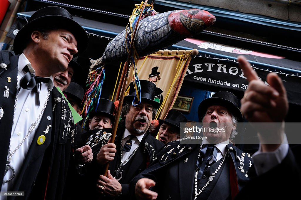 The Brotherhood of the ''Burial of the Sardine'' sing and dance outside a tavern during the Burial of the Sardine procession on February 10, 2016 in Madrid, Spain. The Sardine procession is a centuries-old Spanish tradition made famous by a painting by Spanish artist Francisco de Goya called 'El Entierro de La Sardina'. The mourners hold a mock funeral procession mourning the end of Carnival through the heart of old 'Castizo' Madrid visiting and enjoying the wines and tapas of local taverns.