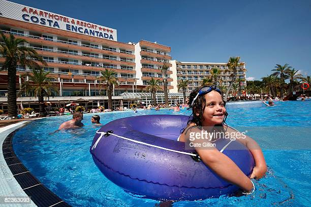 The Brown family and daughter April enjoy the pool at the Costa Entantada Hotel on August 15 2008 in Lloret de Mar Spain Feeling the pinch from the...