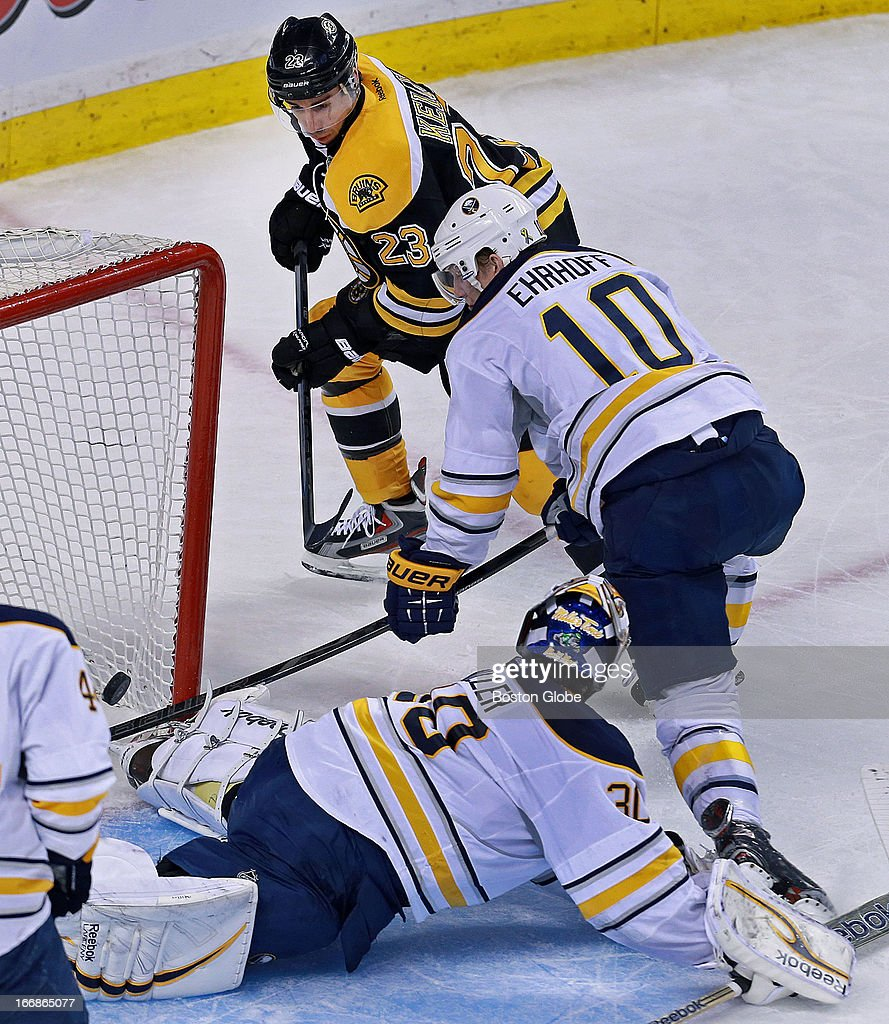 The Bruins Chris Kelly beats Sabres goalie Ryan Miller to put Boston ahead 2-0 in the second period. Buffalo defenseman Christian Erhoff (#10) is in the middle. The Boston Bruins hosted the Buffalo Sabres in a regular season NHL game at TD Garden.