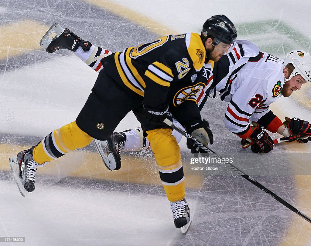 The Bruins Daniel Paille (#20) battles Chicago's Bryan Bickell in the first period. The Boston Bruins hosted the Chicago Blackhawks for Game Six of the Stanley Cup Finals at TD Garden, June 24, 2013.